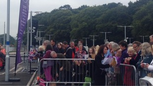 A crowd has gathered at Tweedbank Station, where the Queen will arrive by train with Scotland's First Minister Nicola Sturgeon.