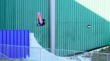 Jamie Nicholls completing a McTwist outside the Snow Centre