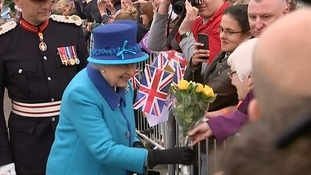 Her Majesty received a bunch of flowers while meeting people who had gathered at Newtongrange Station.