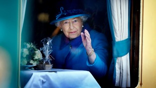 Queen Elizabeth II waved out of the window of the steam locomotive Union of South Africa on the day she becomes Britain's longest reigning monarch.