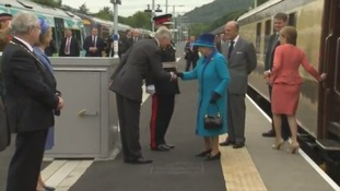 The Queen arrives at the station.