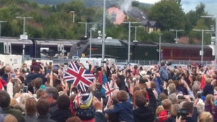 Crowds welcome the Royal Train's arrival.