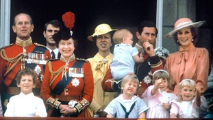 The Prince of Wales with the Princess of Wales, baby Prince Harry, Prince William, the Duke of Edinburgh, Prince Edward, Queen Elizabeth II and Princess Anne on the balcony of Buckingham Palace, London to watch the fly past.