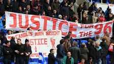 Liverpool fans hold up a 'Justice for the 96' banner