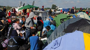 Tightly packed people and tents at the refugee camp at Roeszke, Hungary,