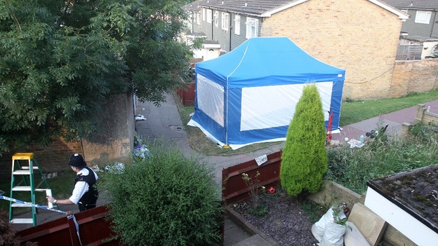 Police tent set up outside the home of Christine Sharp