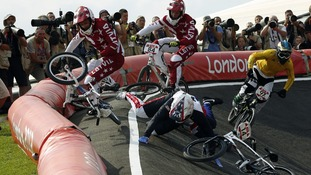 Latvia's Rihards Veide and Edzus Treimanis crash with France's Quentin Caleyron as Australia's Khalen Young