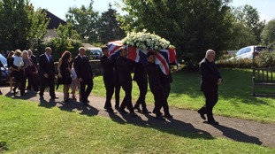 Justin Wilson's coffin is carried into church