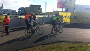 Cyclists arriving to watch.
