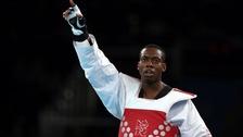 Great Britain's Lutalo Muhammad celebrates after winning bronze against Armenia's Arman Yeremyan.
