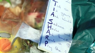 Flowers and messages to Tia Sharp as police continue to identify body