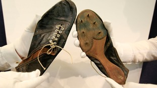 The thin leather running spikes weigh four and a half ounces