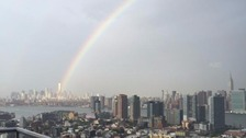 The rainbow appears from the site of the Twin Towers