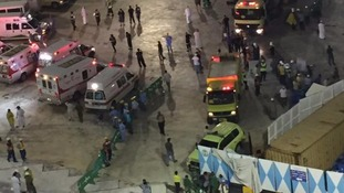 Saudi emergency services gather at the scene.