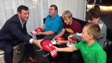 Young boxing fans meet their hero.