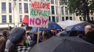 People gathering to support refugees