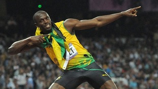 Usain Bolt celebrates in his usual style after winning the Men's 200m Final