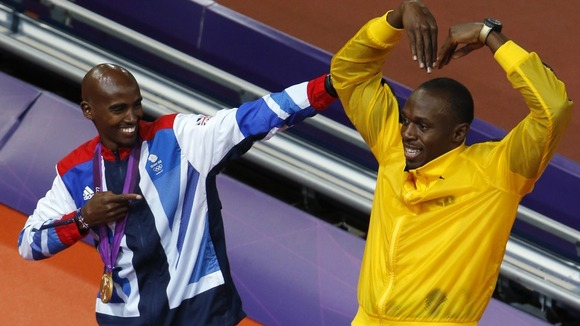Britain's Mo Farah (L) and Jamaica's Usain Bolt pose during the victory ceremony at the Olympic Stadium.