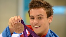 Great Britain's Tom Daley as he celebrates his bronze medal in the men's 10m platform final.