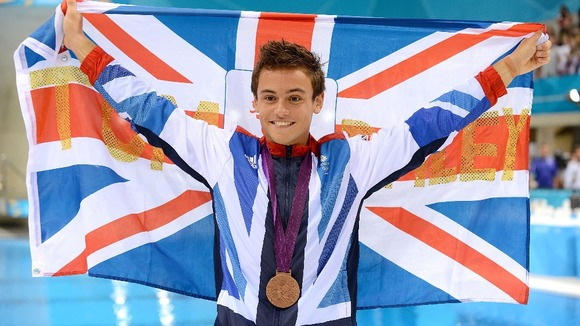 Daley celebrates his first Olympic medal.