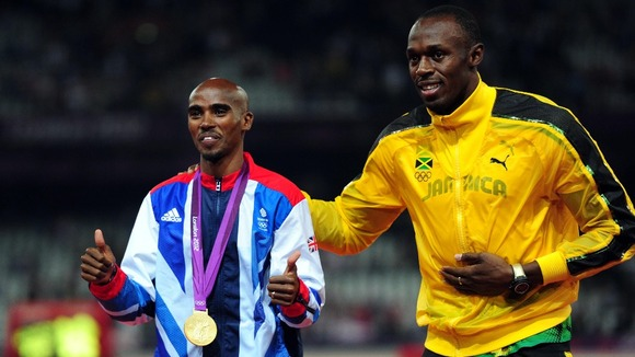 Bolt congratulates Farah on his 5,000m gold medal success.