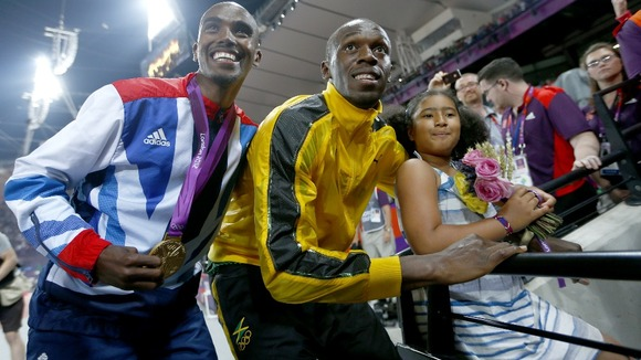 Jamaica's Bolt celebrates with Britain's Farah and Farah's daughter, Rhianna.