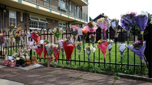 Flowers outside a block of flats, in Mitcham, south London, where Natalie Sharp, the mother of Tia Sharp, lives.