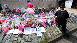 Floral tributes to Tia Sharp.