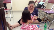 Lindsay Sandiford plays with her two-year-old granddaughter