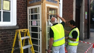 A phone box is painted gold to honour Luke Campbell