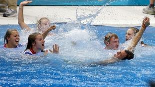 Tom Daley celebrates his Bronze medal in the Men's 10m Platform Final at the Aquatics Centre