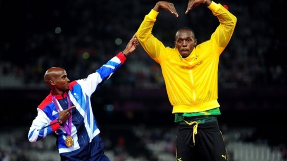 Usain Bolt and Mo Farah celebrate Mo's gold medal