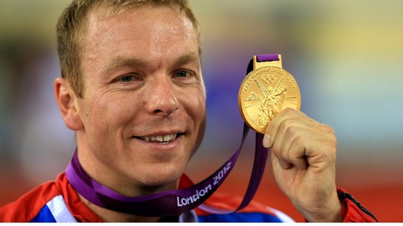Great Britain's Sir Chris Hoy celebrates winning a gold medal