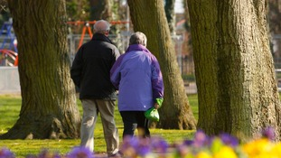 File photo dated 14/03/13 of a couple walking through a park