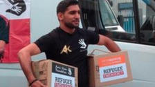 Amir Khan with some of the donations for the convoy.