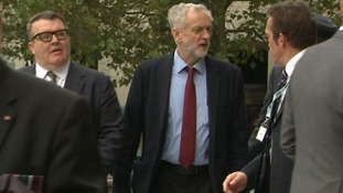 Jeremy Corbyn, centre, arrives with deputy leader Tom Watson, left.