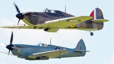 A Hurricane (top) and a Spitfire during the Battle of Britain Flypast at Goodwood Aerodrome today