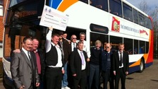 Corby bus drivers collect their winnings