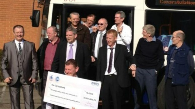 The Corby bus drivers and their 38 million lotto cheque. 