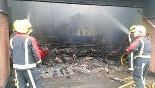 Firefighters damp down following the blaze