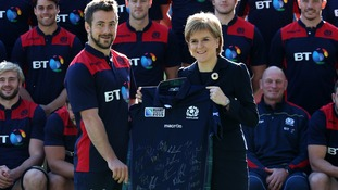First Minister Nicola Sturgeon is presented with a signed jersey by captain Greig Laidlaw (centre left) as she meets the Scotland Rugby World Cup Squad at Murrayfield Stadium ahead of the World Cup.