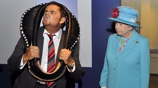 Queen Elizabeth II watches Tommy Mattinson, the world Gurning champion