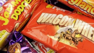 Men charged after £20,000 biscuit theft