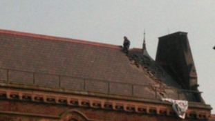 Viewer picture of man on roof.