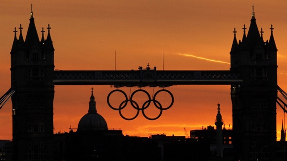 Sun sets behind the Olympic rings on Tower Bridge
