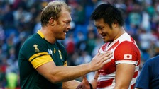 South Africa's Schalk Burger shakes hands with Japan's Shinya Makabe after the match