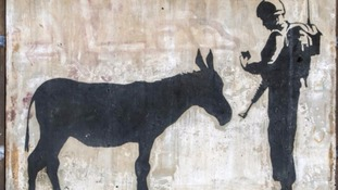 Banksy's Donkey Documents was cut away from the wall of a building in Bethlehem with the owner's consent