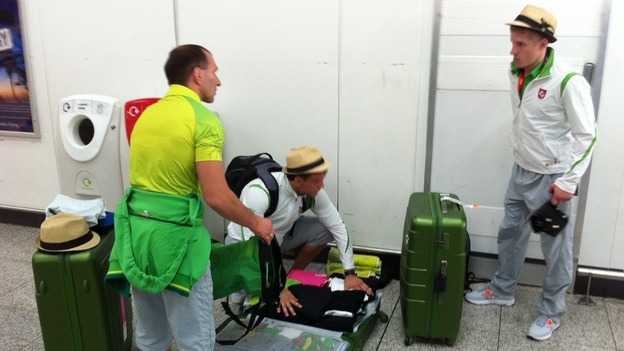 Athletes check their luggage before heading home