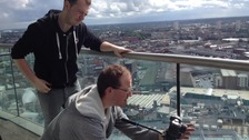 Graphic designers Ben and Gareth on the 20th floor of the rotunda discuss what shots will work in the titles