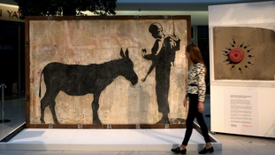 West Banksy: Artist's donkey mural gets UK display
